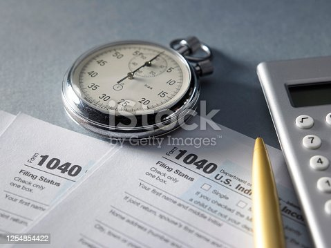 1040 tax form stopwatch and and calculator