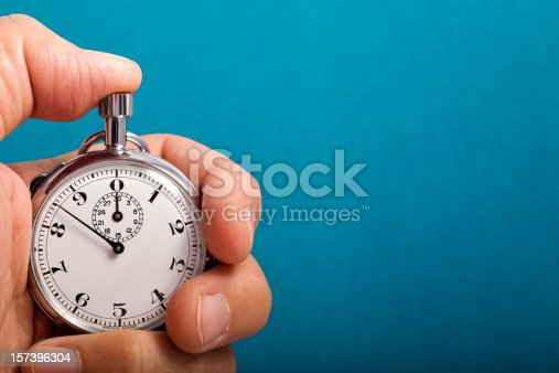 Vintage, analog stopwatch in hand.