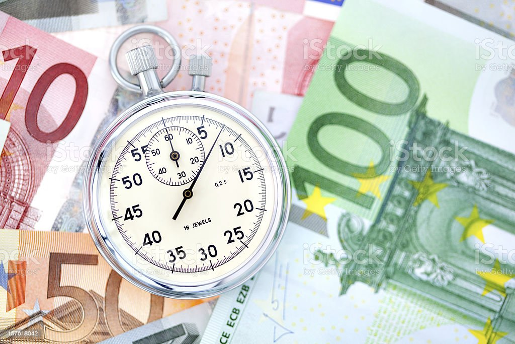 stop watch on euro bank notes royalty-free stock photo