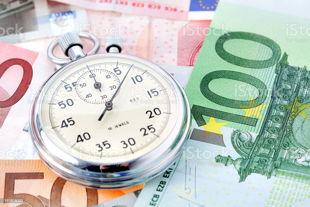 stop watch on money royalty-free stock photo