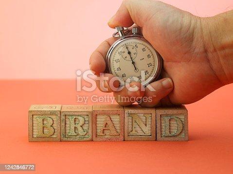 1140385944 istock photo stop watch on single word brand 1242846772