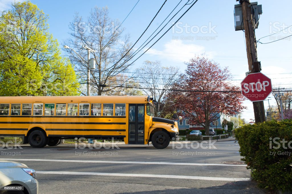 Stopped sign and School Bus stock photo