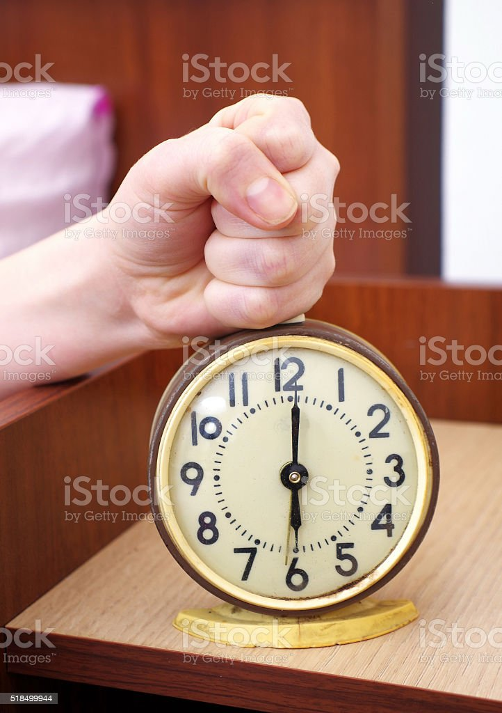 Stopping The Alarm Clock In The Bedroom Stock Photo - Download Image Now