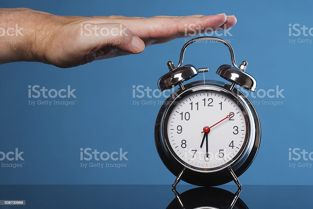 stopping the alarm stock photo