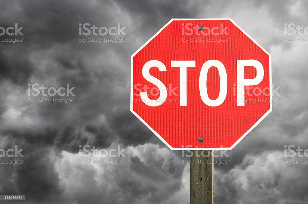 Stop-sign on Storm Clouds royalty-free stock photo