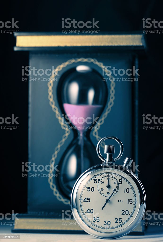 Stopwatch and sand watch stock photo