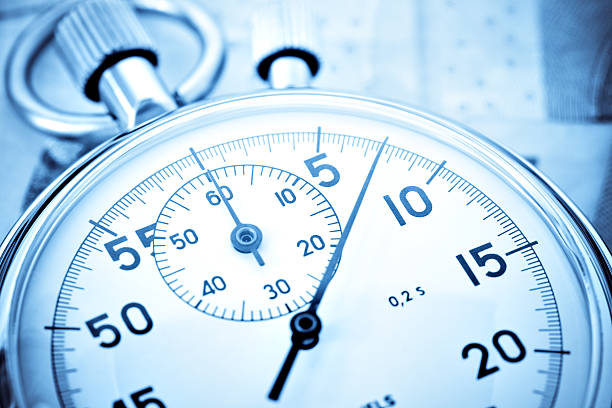 stopwatch closeup with high contrast - stop watch stock photos and pictures
