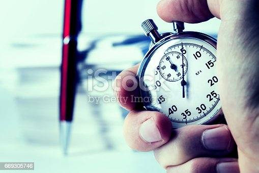 istock Stopwatch in hand 669305746