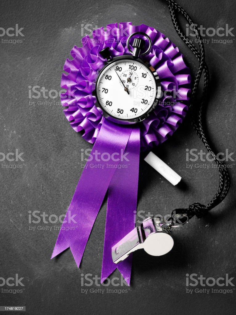 Stopwatch in the Centre of a Purple Rosette with Whistle royalty-free stock photo