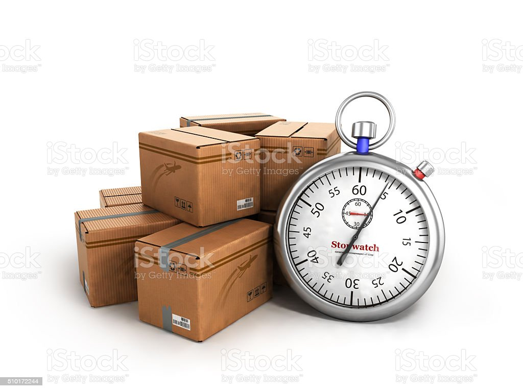 stopwatch next to the boxes, the concept of fast delivery stock photo