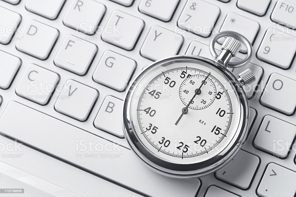 Stopwatch on a keyboard stock photo