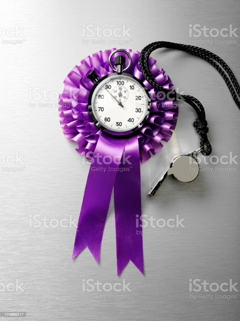 Stopwatch on a Purple Rosette with Whistle royalty-free stock photo