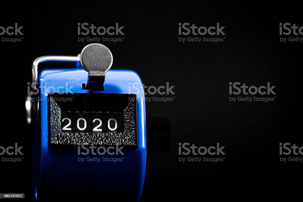 Stopwatch pointing to 2020 stock photo