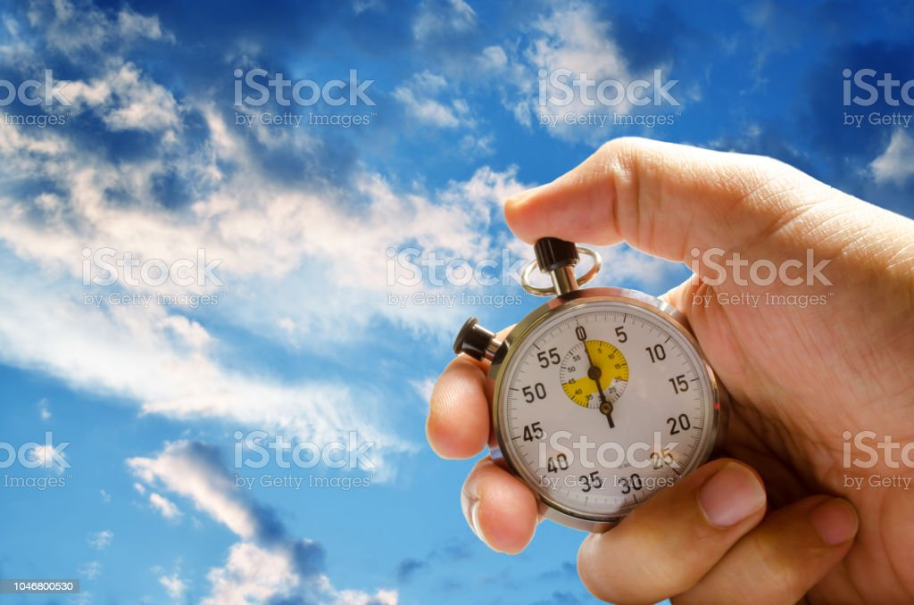 stopwatch pushed button hold man hand stock photo