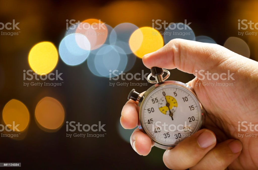 stopwatch pushed button on man hand stock photo