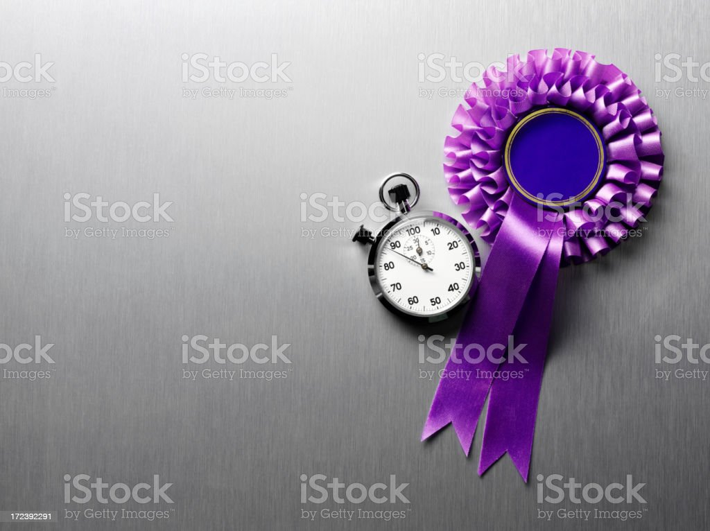 Stopwatch with a Purple Rosette on Stainless Steel royalty-free stock photo