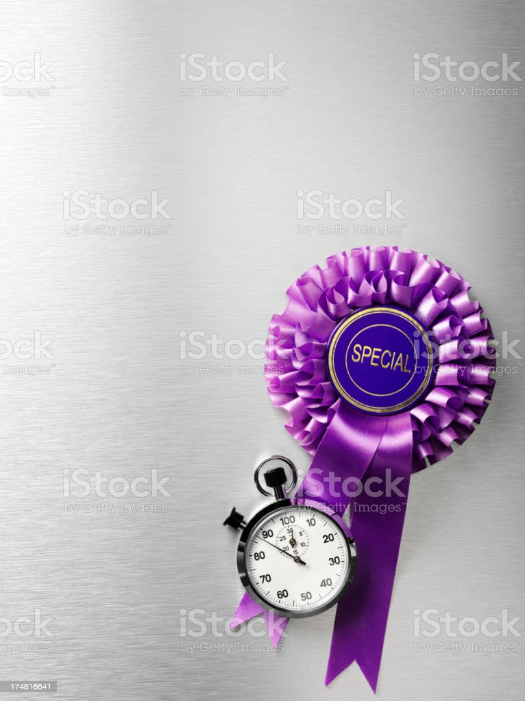 Stopwatch with a Special Purple Rosette Ribbon royalty-free stock photo