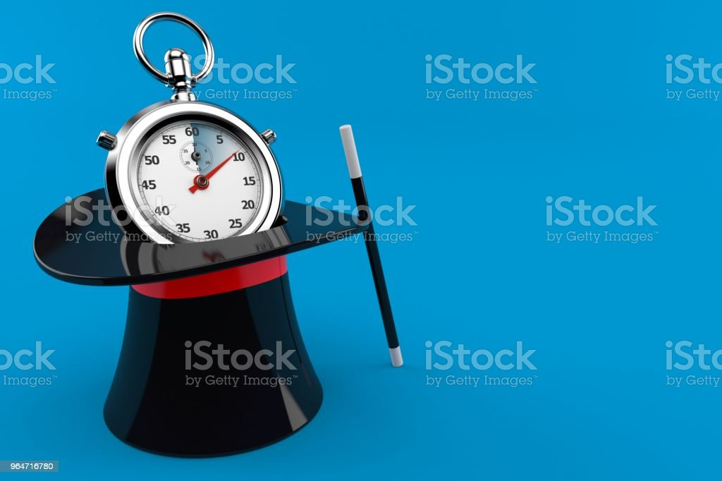 Stopwatch with magic hat royalty-free stock photo