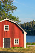 A red storage building on the swedish countryside.