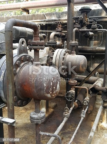 1001622522 istock photo Storage bunker- c tank  inside the used oil room, and that tank was also heated by steam and have explosion proof equipment  for  valve,motor, pump and fire protection 917101988