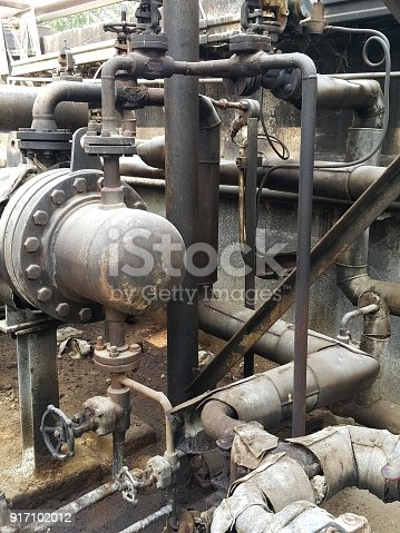 1001622522 istock photo Storage bunker- c tank  inside the used oil room, and that tank was also heated by steam and have explosion proof equipment  for  valve,motor, pump and fire protection 917102012