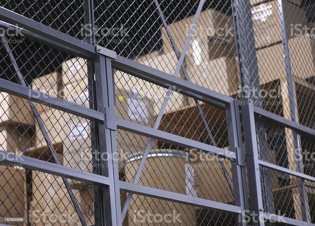 Storage cage with several carton boxes in shelfs royalty-free stock photo