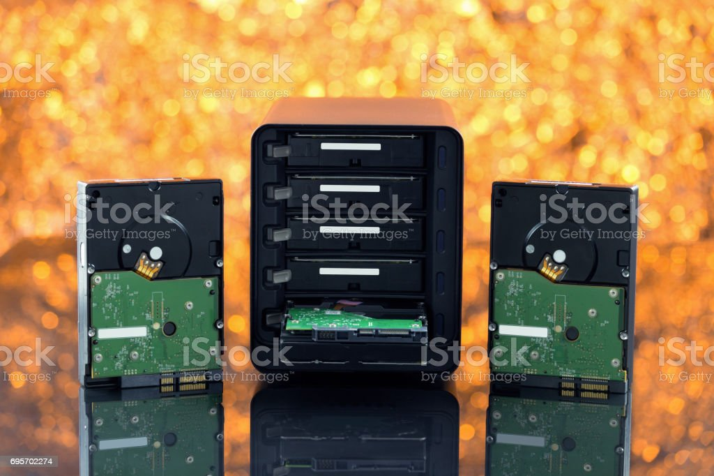 NAS, storage connected to the network. Several hard drives. HDD. On yellow background stock photo