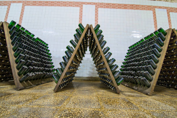 storage hall of white sparkling wine bottles in the cellars of winery - moldova stock pictures, royalty-free photos & images