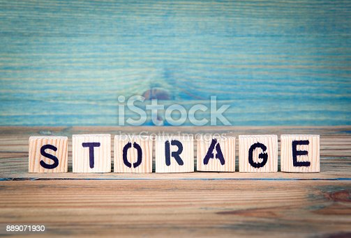 istock storage - name from wooden letters. Office desk, informative and communication background 889071930
