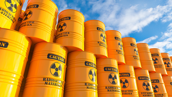 Storage of yellow barrels with nuclear waste on outdoor sky. 3d render