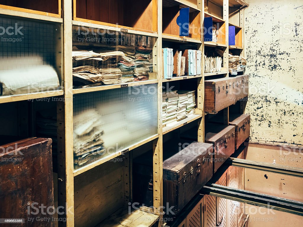 Storage room Old shelf with Stack of papers stock photo