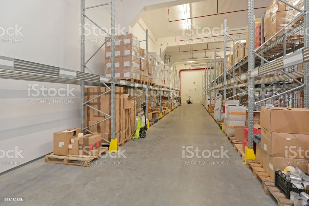 Boxes at Shelves in Long Storage Room Warehouse