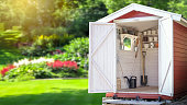 istock Storage shed filled with gardening tools. 1125671420