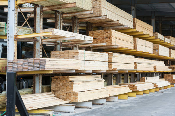 Storage shelves in lumberyard Warehouse at a lumberyard with stacks of construction material on shelves. timber stock pictures, royalty-free photos & images