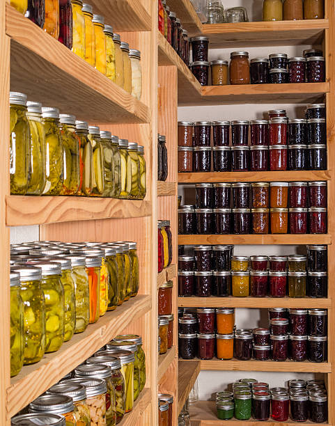Storage shelves with canned food stock photo