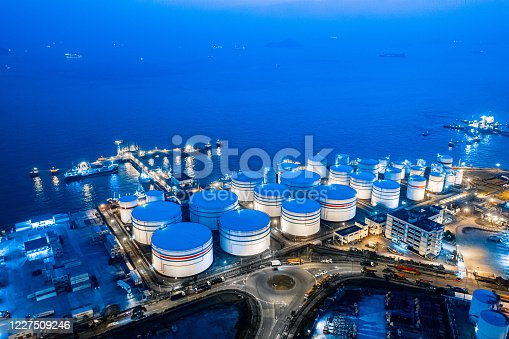 Storage tank of liquid chemical and petrochemical product tank, Aerial view at night. Hong Kong