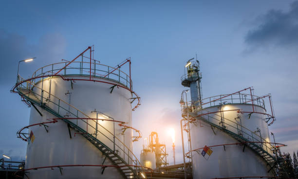 storage tank petrochemical plant with flare stack stock photo
