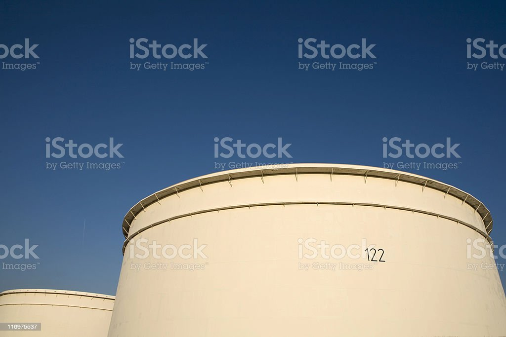 storage tanks at an oil refinery against a blue sky royalty-free stock photo