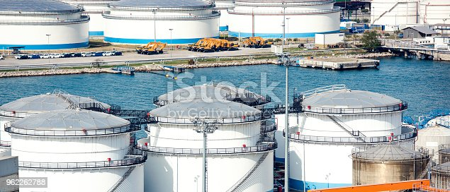 Liquid gas storage tanks in harbour.