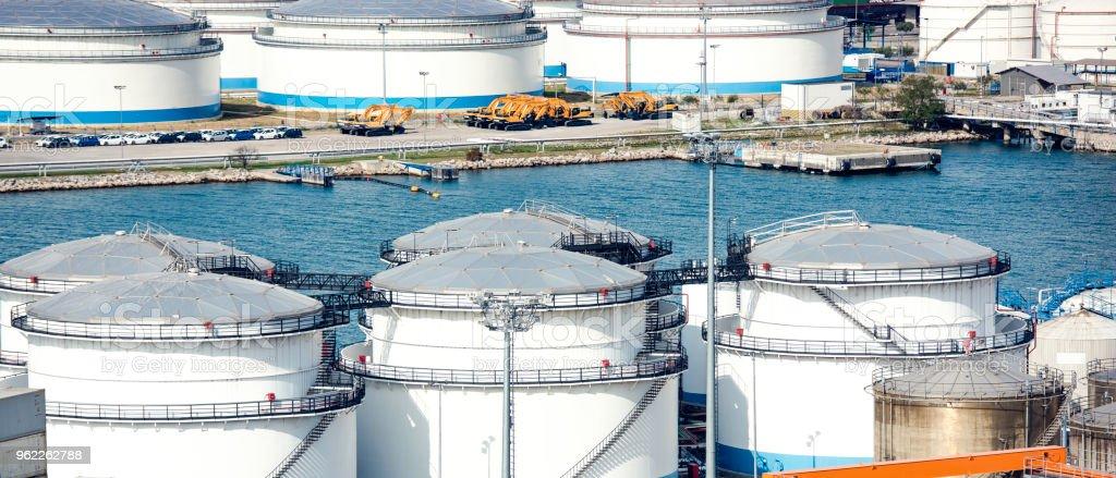Storage tanks at harbor stock photo