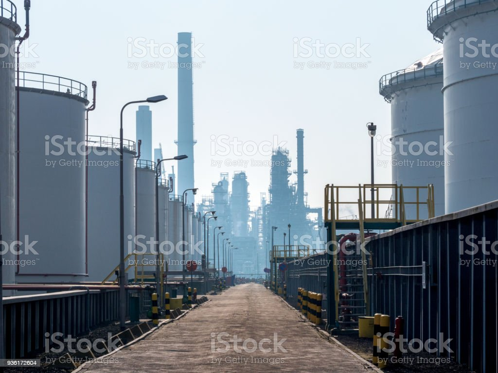 storage tanks in a row near the port of Rotterdam The Netherlands,In the back petrochemical plant stock photo