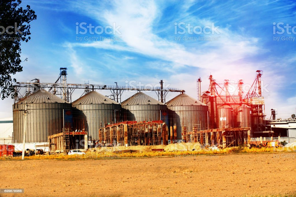 storage tanks in rice mill, factory process production line in India stock photo