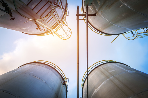 Stainless tanks and pipeline for liquid chemical industrial on sky background