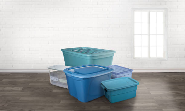 storage totes boxes in an empty room with a window - bin stock pictures, royalty-free photos & images