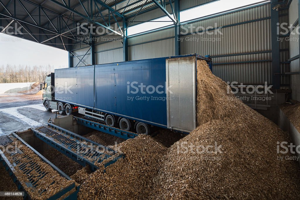Storage warehouse for wood chips stock photo