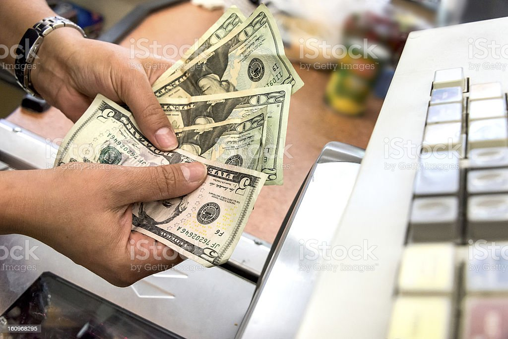 Store cashier counting the cash stock photo