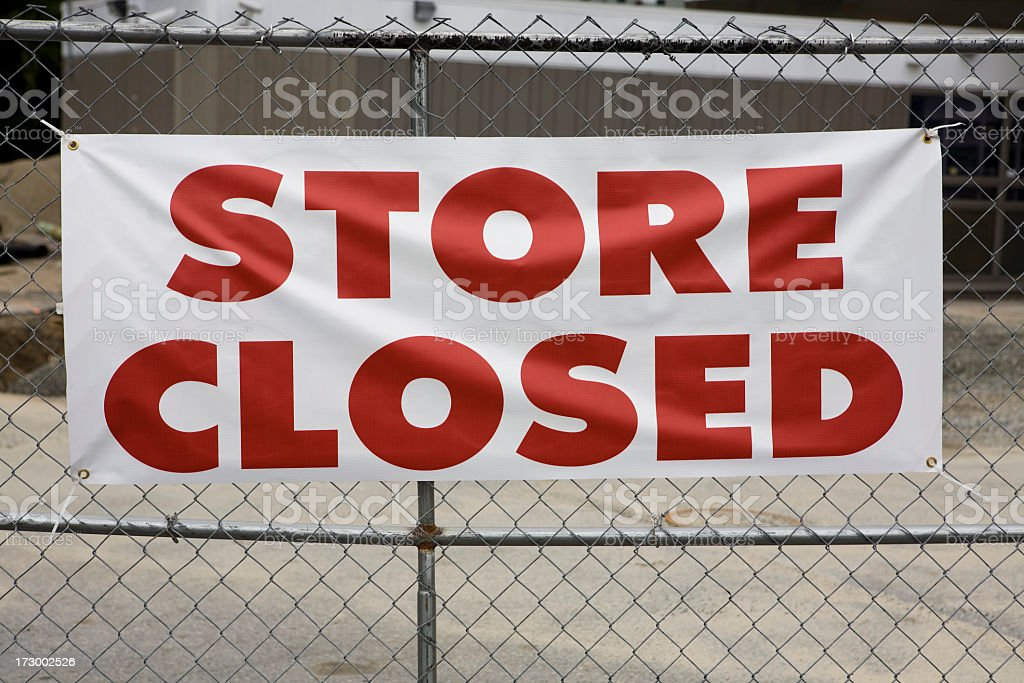 Store Closed Sign showing Bankruptcy of Retailer stock photo