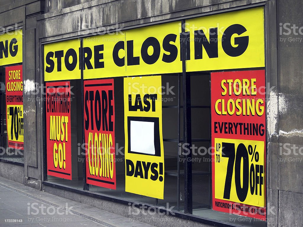 Store Closing and discount signs in department store windows stock photo