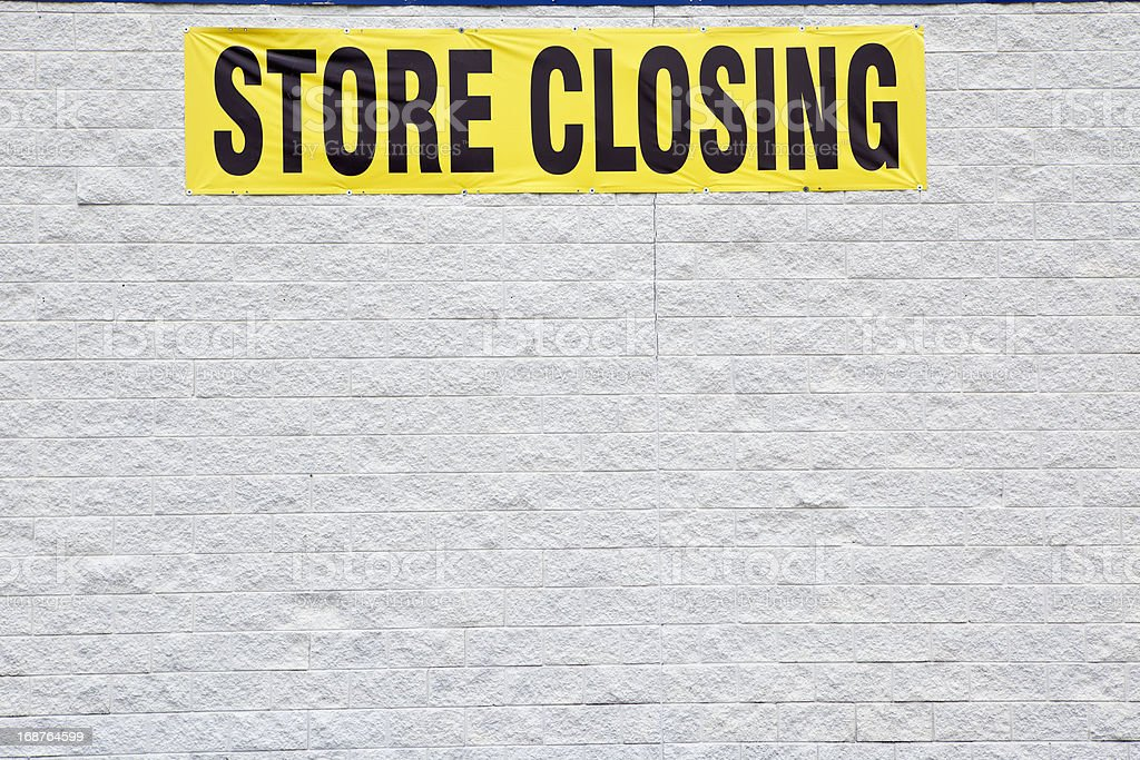 Store Closing Banner on Side of Buliding royalty-free stock photo