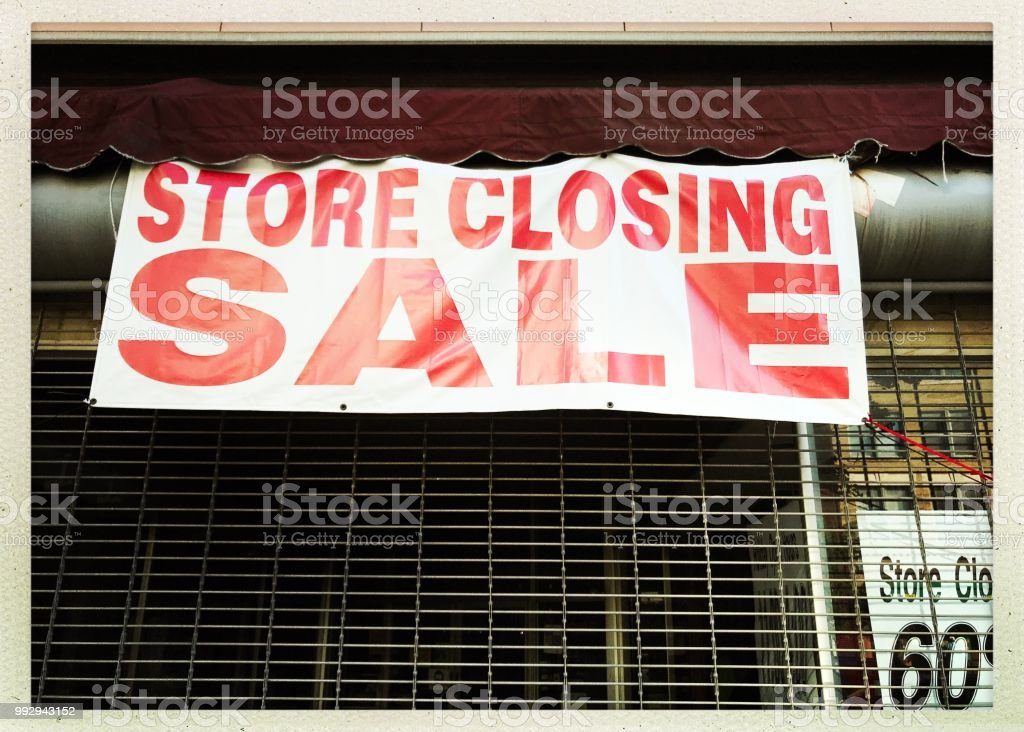 Red and white store closing sign. iPhone